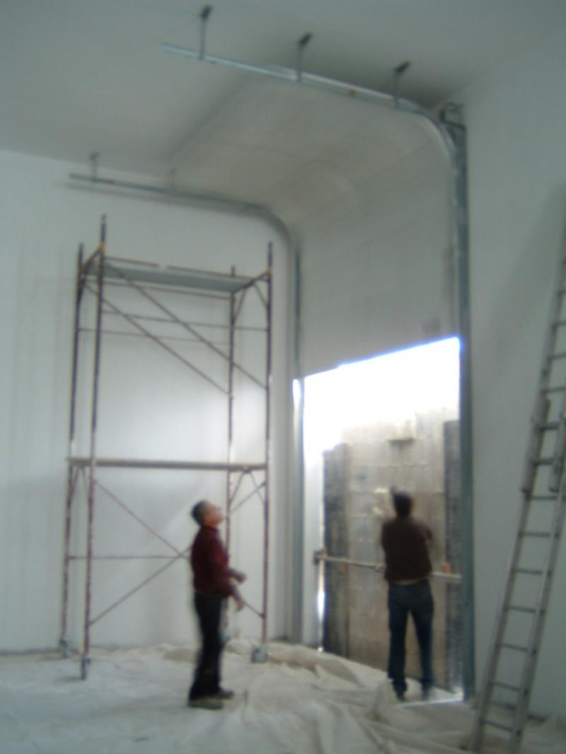 Insulated Sectional Door that goes up with the ceiling