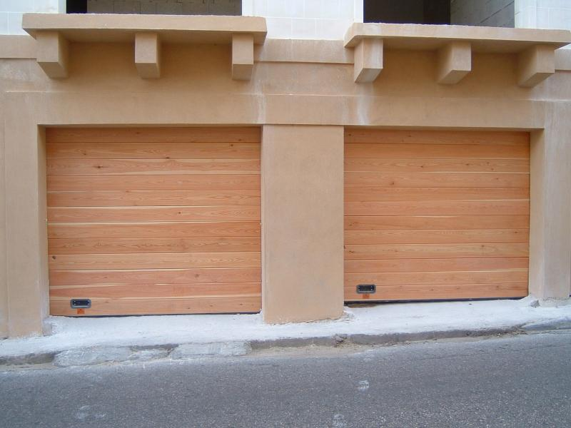 Two Sectional Doors covered in real wood