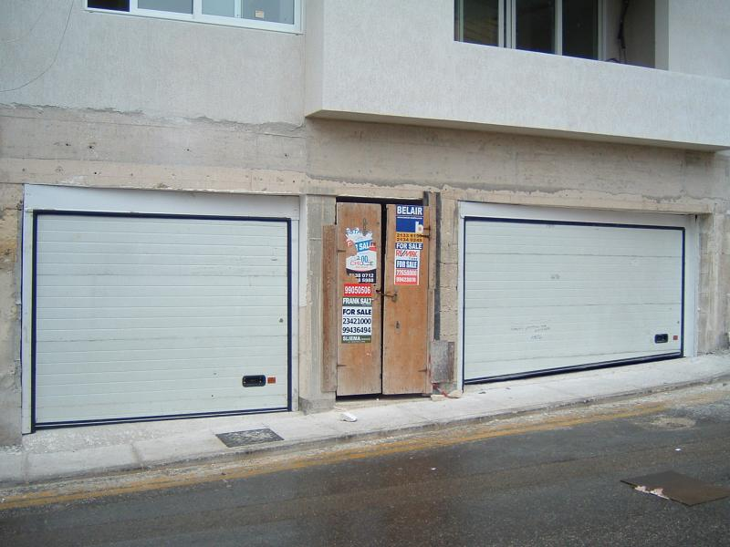 Two white sectional Doors